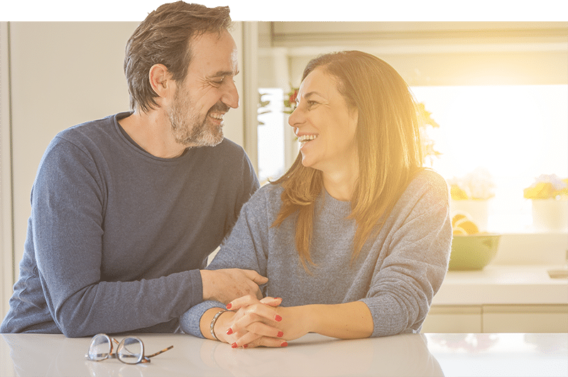 couple smiling at each other - tax management services