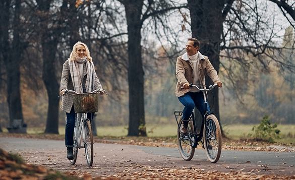 couple on a bike ride - finance advising